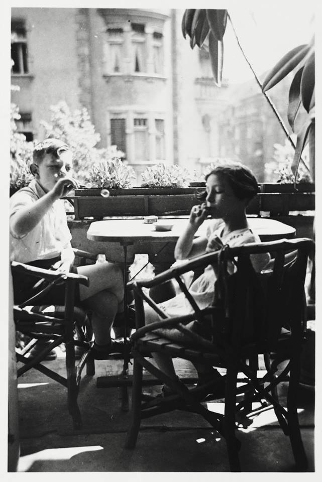 Peter and Marion Witting blow bubbles on the balcony of their apartment in Katowice, Poland, 1938. Photograph courtesy of the United States Holocaust Memorial Museum.