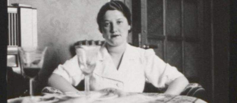 Lilly Roth poses at an indoor table in her home in Hungary, 1925-1930. Courtesy of United States Holocaust Memorial Museum.