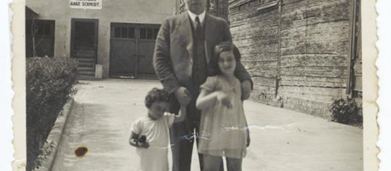 A Jewish father stands with his two daughters in the courtyard of their home, Kaunas, Lithuania, 1932-1934. Photograph courtesy of the United States Holocaust Memorial Museum.